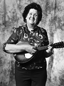 Rita Maloney: What drew me to country music is that my husband and I wanted something to do when we retired. I started playing the chord organ then the ukulele. I've been playing the mandolin for several years and I also play the banjo, sing and yodel.
