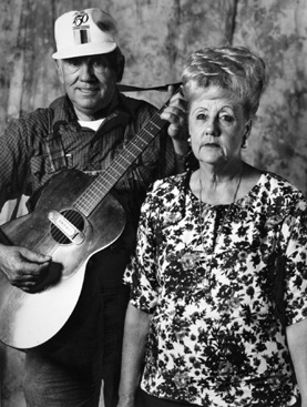 "Robert and Willie Kate Maness: Both Robert and Willie play the guitar. Robert's ""pride and joy"" is his 1955 Martin guitar. He bought it new in Omaha for $89 many years ago."