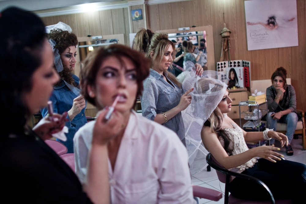 Iran, Tehran, Women being made-up in a beauty salon where it is illegal for men to enter as it is for men to do a woman's make-up.