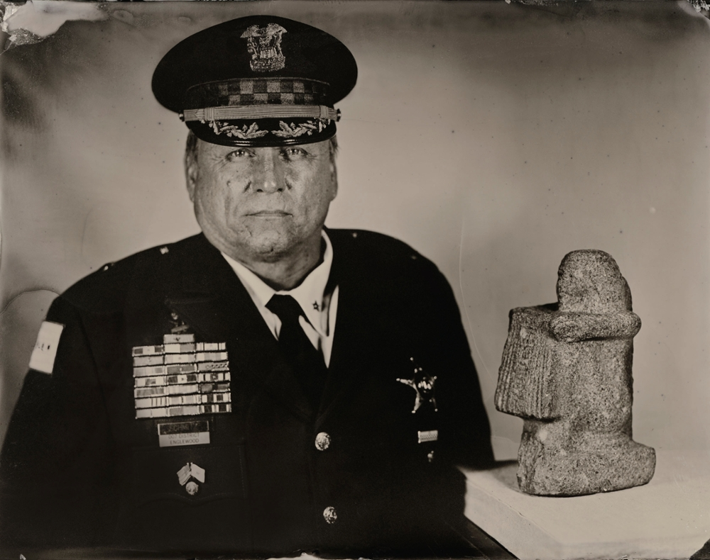 Chicago Police Deputy Chief of Patrol Leo Schmitz and a statue of the Police Chief of Western Thebes, 2013