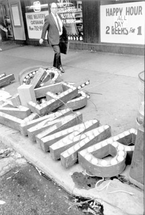 Man Walking by Movie Marque Letters, Chicago, from the Changing Chicago Project