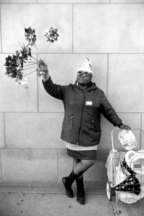Woman Selling Pinwheels, Chicago, from Changing Chicago