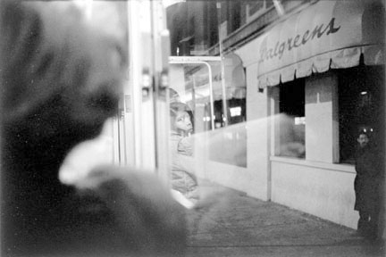 Woman's Reflection in a Bus Window, Chicago, from the Changing Chicago Project