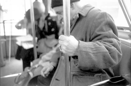 Man with Rings Riding a Bus, Chicago, from the Changing Chicago Project