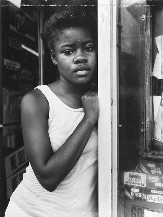 A Girl in the Deli Doorway