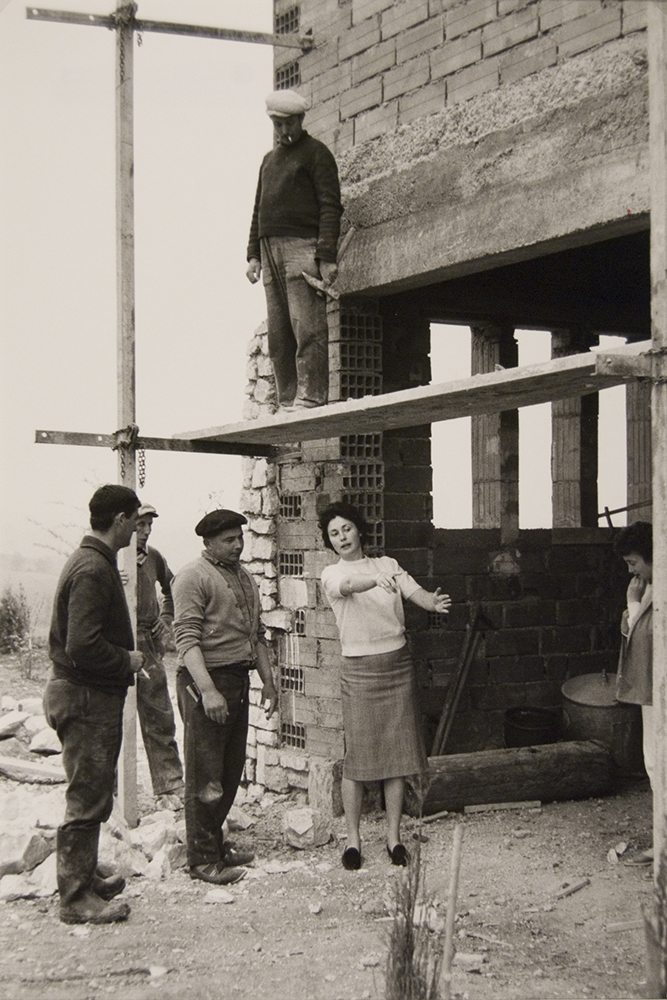 Woman Giving Directions to Construction Workers, Algeria