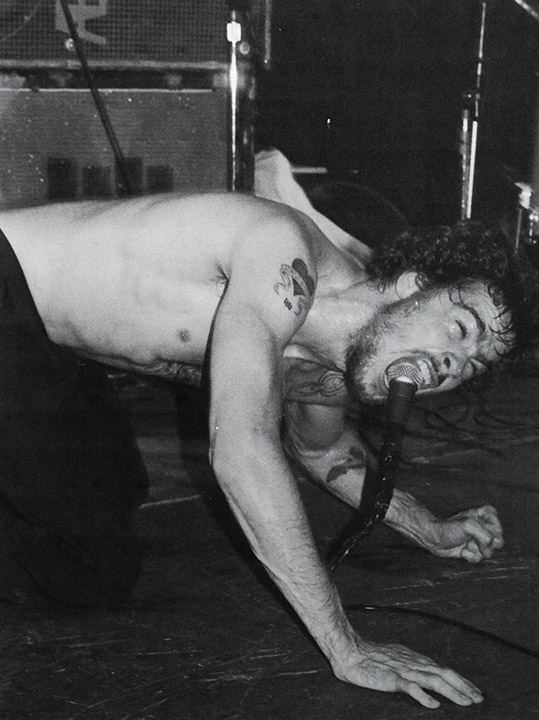 Untitled (Henry Rollins of Black Flag Screaming with a Microphone in His Mouth)