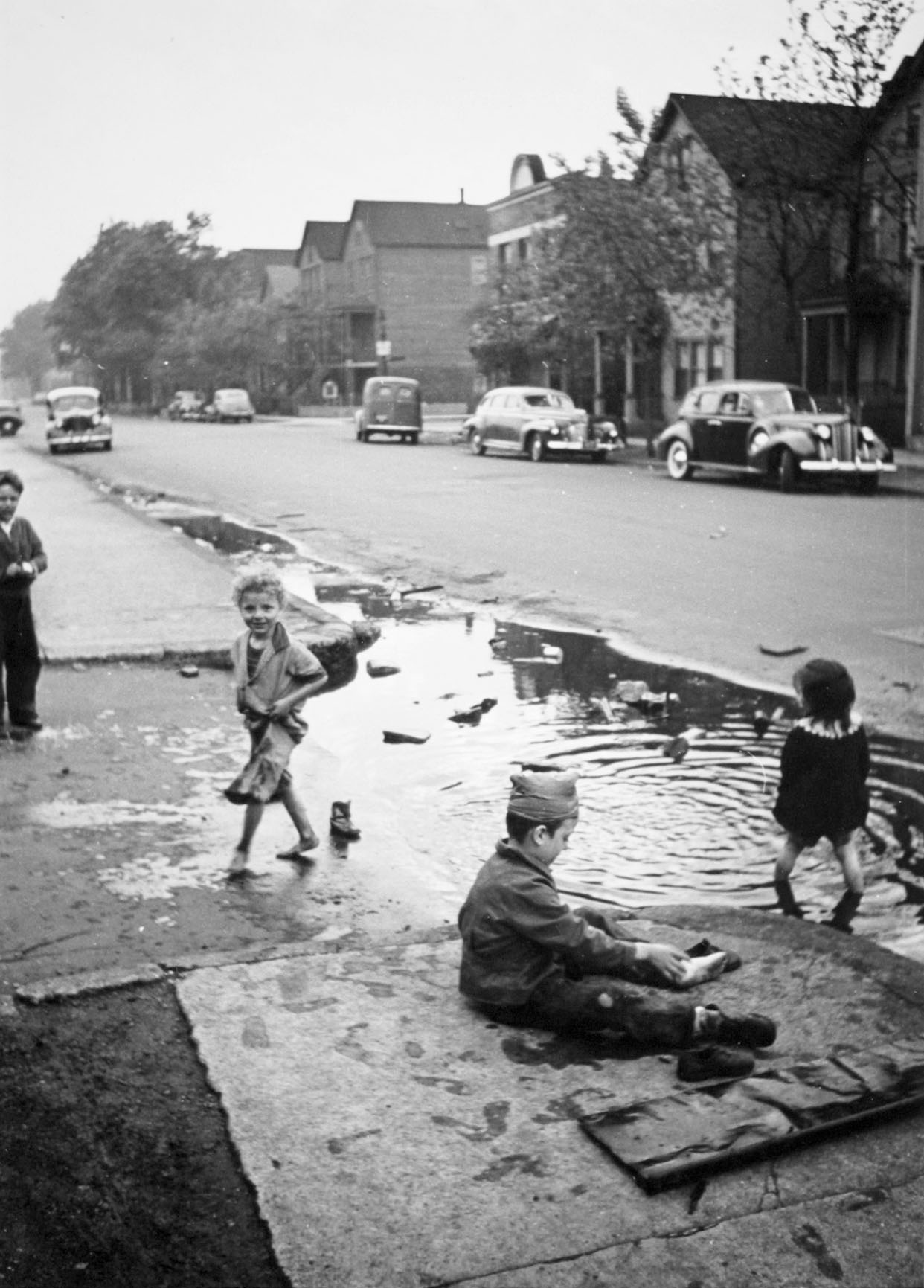 Children Playing in a Puddle