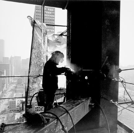 Ironworker Welding a Joint, 900 N. Michigan Avenue, from Changing Chicago