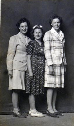 Untitled (three women standing close together)