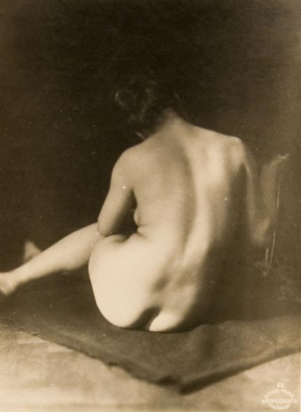 Untitled #55 (back view of seated female nude on dark blanket)