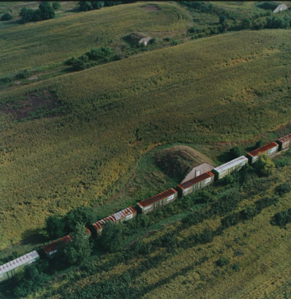Abandoned bunkers and train, now a cornfield, September 1995.  Former Joliet  Arsenal, Illinois