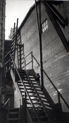 Untitled (side view of building and wooden fire escape, New York)