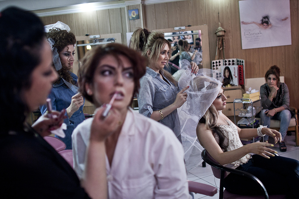 Tehran, Iran. Women being made up in a beauty salon where it is illegal for men to enter, as it is for men to do a woman's makeup.