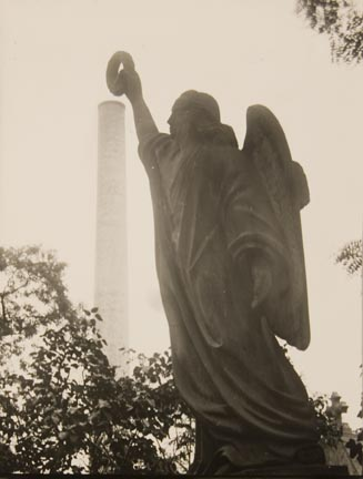 Untitled (angel sculpture holding up wreath)