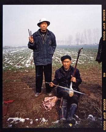 Ma Guozhong (right) Age 59, from the
