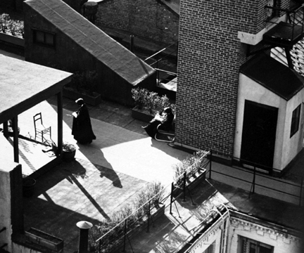 New York (nun reading on rooftop)