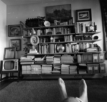 Untitled (Andre's feet in front of study books)