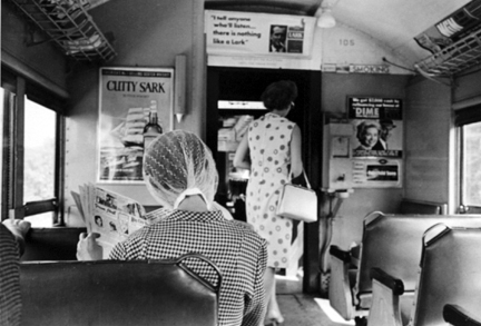 L.I. Train (woman reading newspaper)