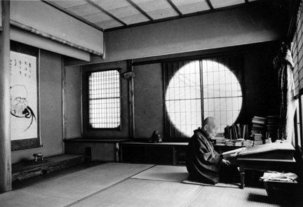 Kyoto, Japan (man seated reading by circular window)
