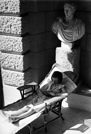 Paris (girl reading in patio chair)