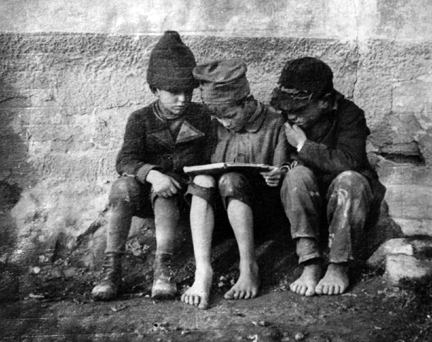 Esztergom, Hungary (three boys reading)