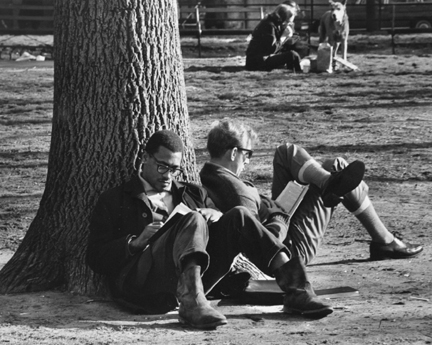 Washington Square, New York (two men reading against a tree trunk)