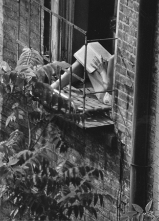 Greenwich Village, New York (woman reading in fire escape window)