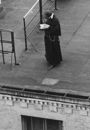 Untitled (nun reading on roof)