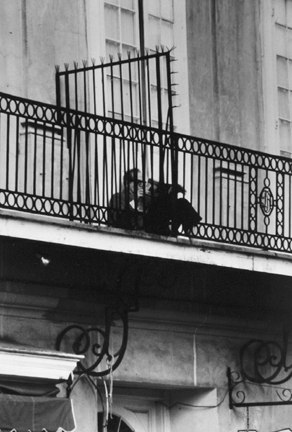 New Orleans, La. (man reading on balcony)