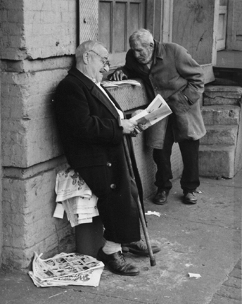 The Bowery, New York (two men reading newspapers)