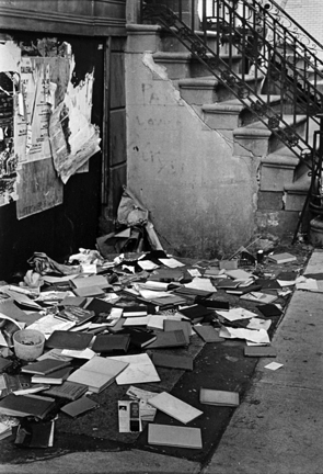 Untitled (books scattered on sidewalk)