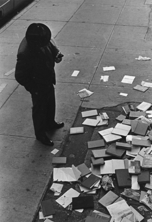 New York (books scattered on sidewalk)