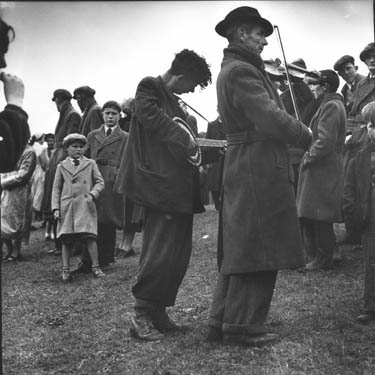 The Dunne brothers of Limerick, one of whom is blind, are well-known for busking at fairs, markets, and in this case a hurling match.