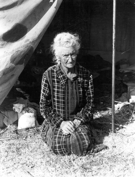 Grandmother of twenty-two children, from a farm in Oklahoma; eighty years old. Now living in camp on the outskirts of Bakersfield, California.