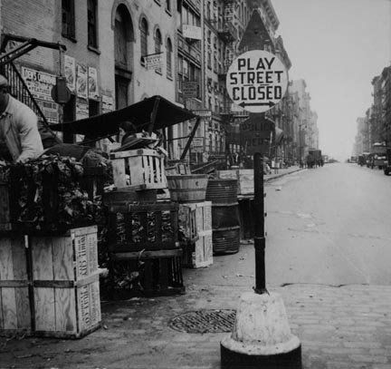 Background photograph for Hightstown project. Play street for children. Sixth Street and Avenue C, New York City. The Solomon family who are to be resettled at Hightstown, live in this neighborhood[…]