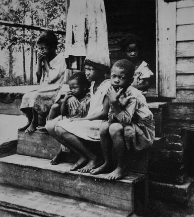 Children of turpentine worker near Cordele, Alabama. The father earns one dollar a day