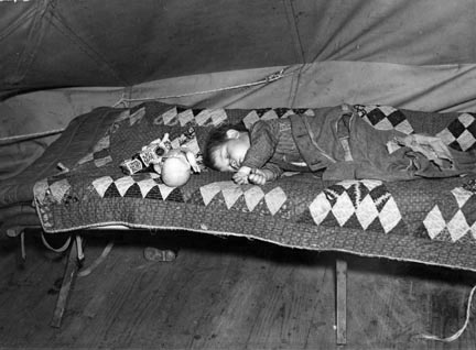 A child flood refugee taking a nap. Tent City near Shawneetown, Illinois