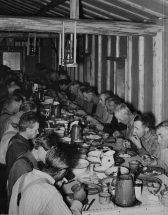 Lumberjacks at dinner. Camp near Effie, Minnesota