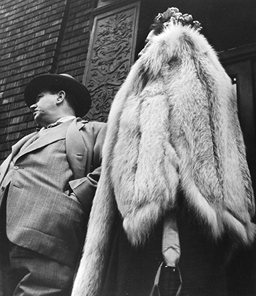 Man in Suit, Woman in Fur Coat
