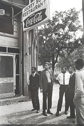 Jimmy Hicks, Julian Bond, John Lewis, and Jeremiah X stand across the street from the bombed church