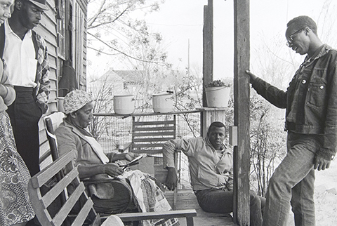 Charles Sherrod (standing at right) and Randy Battle (seated) visit a supporter in the Georgia countryside. Sherrod married there and thirty years later is still in southwest Georgia, a member of the Albany City Council.