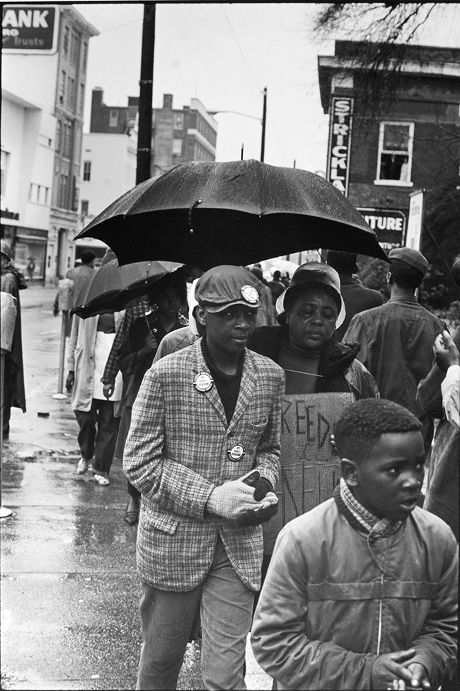 Fannie Lou Hamer, sharecropper from a family of twenty children, evicted from her home for applying to register to vote, severely beaten in the Winona police station, SNCC field secretary from Ruleville, and future Mississippi Freedom Democratic party candidate for Congress, marches in the cold Hattiesburg rain