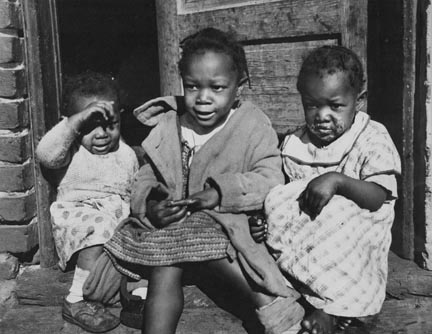Negro youngsters in doorway of alley dwelling. Washington, D.C.