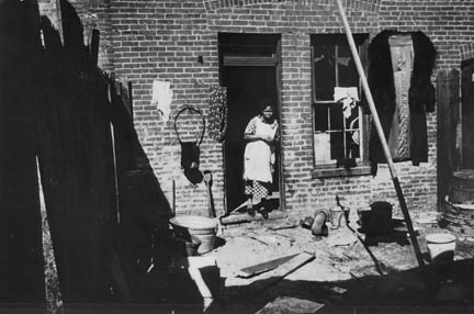 Backyard of Negro dwelling in slum area near the House office building, Washington, D.C.