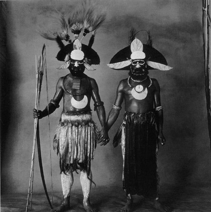 Two New Guinea Men Holding Hands