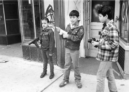 A Group of Young Boys Play 'Cops' in S. Chicago