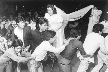 A Snake Dance is Held at a Wedding Reception at the Farolito Club in South Chicago, from Changing Chicago