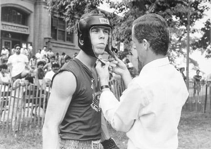 A Boxer and His Trainer Prepare for a Battle at East Sides Annual Labor Day Festivities at Calumet Park