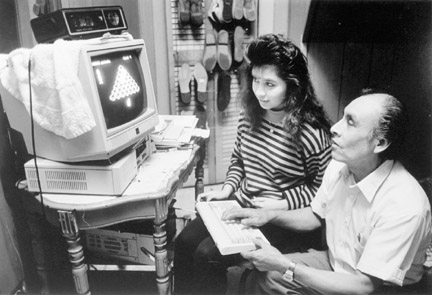 Mr. Rodriguez and Daughter Play Computer Games in Sons Bedroom